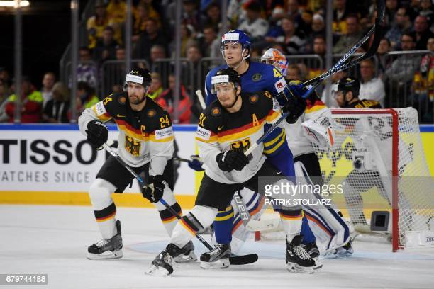 Germany´s Moritz Muller and Sweden´s Victor Rask vie for the puck during IIHF Icehockey world championship first round match between Sweden and...