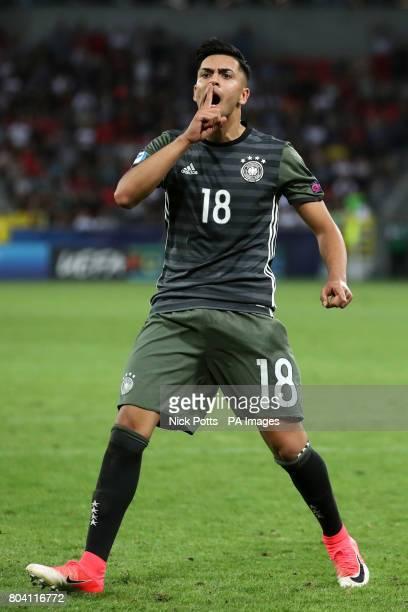 Germany's Nadiem Amiri celebrates scoring his penalty during the shootout