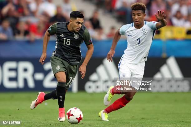 Germany's Nadiem Amiri takes on England's Mason Holgate