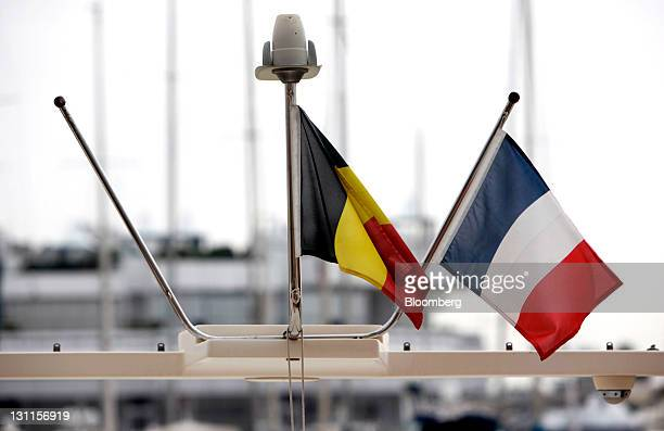 Germany's national flag center flies alongside France's national flag from a boat moored at Cannes' main harbor ahead of tomorrow's Group of 20...