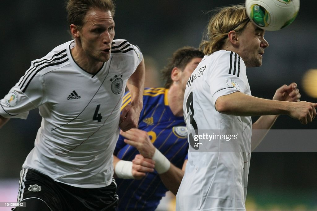 Germany's national football team players Benedikt Höwedes (L) and Marcel Schmelzer (R) are in action during their 2014 World Cup qualifying football match against Kazakhstan's national football team in the Kazakh capital Astana, on March 22, 2013.