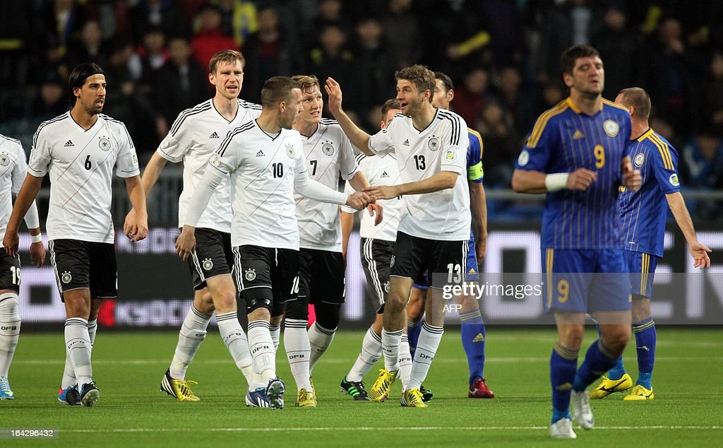 Germany's national football team players celebrate their goal against Kazakhstan's national football team during their 2014 World Cup qualifying football match in the Kazakh capital Astana, on March 22, 2013.