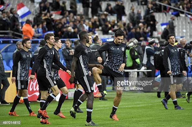 Germany's national football team players warm up prior to a friendly international football match between France and Germany ahead of the Euro 2016...