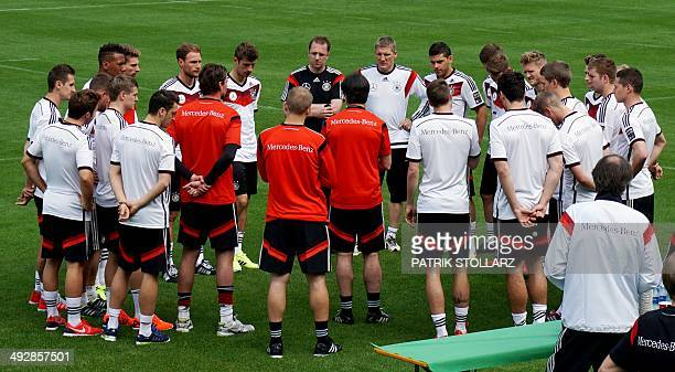 Germany's national soccer team head coach Joachim Loew speaks to his players during the team's first training session on a training ground in San...