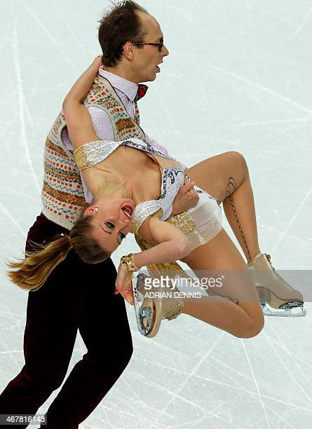 Germany's Nelli Zhiganshina and Germany's Alexander Gazsi perform in the Figure Skating Team Ice Dance Short Dance at the Iceberg Skating Palace...