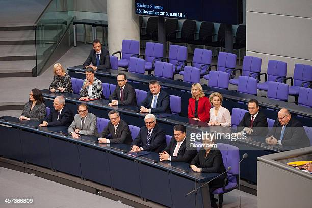 Germany's new government left to right front row Andrea Nahles Germany's labor and social affairs minister Wolfgang Schaeuble Germany's finance...