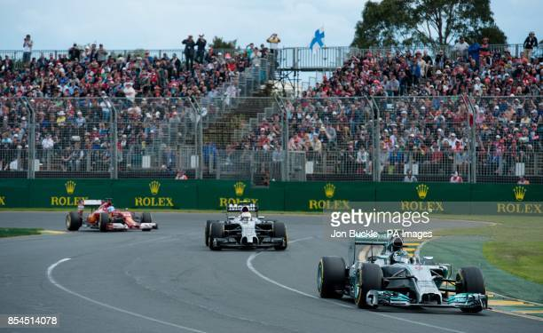 Germany's Nico Risberg of Mercedes AMG Petronas leads Denmark's Kevin Magnussen of McLaren Mercedes and Spain's Fernando Alonso of Scuderia Ferrari...