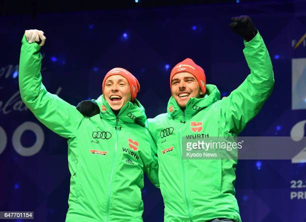 Germany's Nordic combined skiers Eric Frenzel and Johannes Rydzek celebrate after winning the men's team sprint gold at the Nordic World Ski...