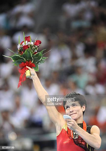 Germany's Oksana Aleksandrovna Chusovitina stands on the podium during the medal ceremony of the women's vault final of the artistic gymnastics event...