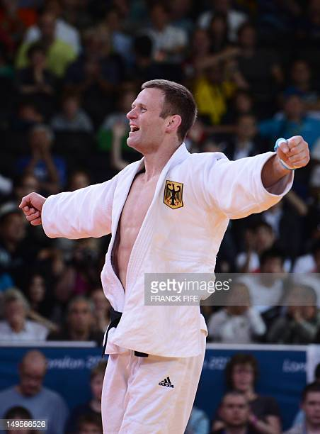 Germany's Ole Bischof celebrates after winning against Japan's Takahiro Nakai during their men's 81kg judo contest quarter final match of the London...