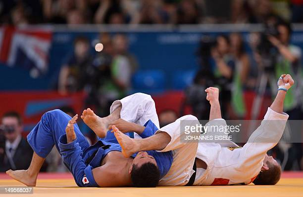 Germany's Ole Bischof celebrates winning against Japan's Takahiro Nakai during their men's 81kg judo contest match of the London 2012 Olympic Games...