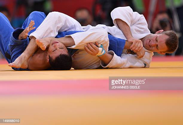 Germany's Ole Bischof competes with Japan's Takahiro Nakai during their men's 81kg judo contest quarter final match of the London 2012 Olympic Games...