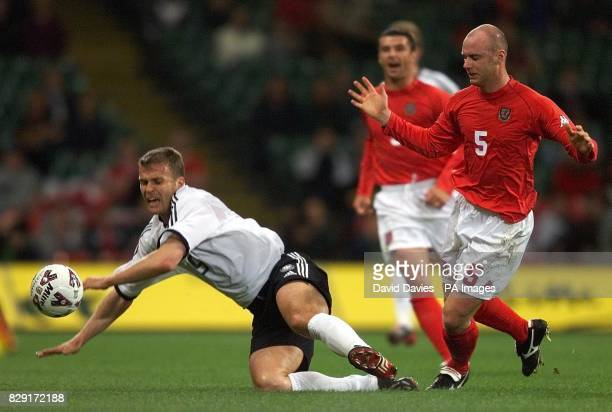 Germany's Oliver Bierhoff goes down under the challenge of Robert Page of Wales during the friendly International at the Millennium Stadium
