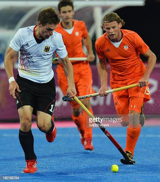 Germany's Oliver Korn vies the Netherlands' Bob De Voogd during the men's field hockey gold medal match Germany vs the Netherlands at the London 2012...