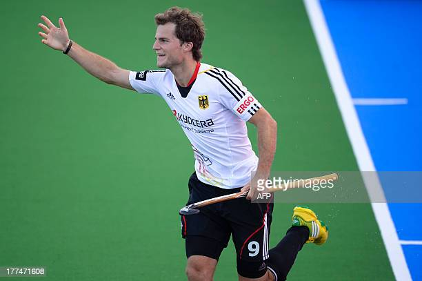 Germany's Oskar Deecke celebrates after scoring on August 23 2013 during the men semifinal field hockey match between The Netherlands and Germany...