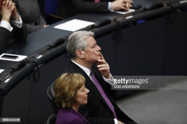 Germany's outgoing President Joachim Gauck and his partner Daniela Schadt listen to the speech of the new German President FrankWalter Steinmeier...