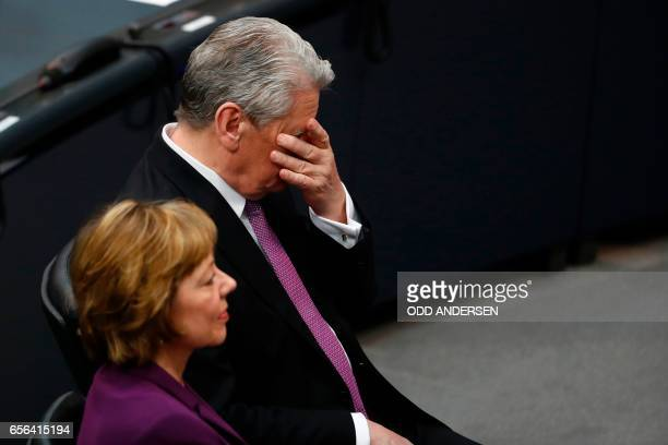 Germany's outgoing President Joachim Gauck gestures as his partner Daniela Schadt listens to the speech of the new German President FrankWalter...