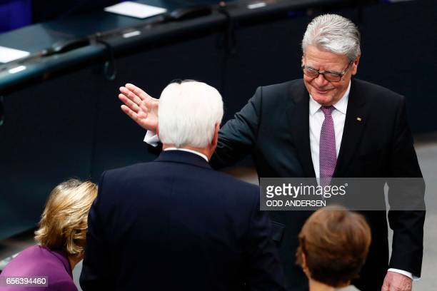 Germany's outgoing President Joachim Gauck gratulates Germany's new President FrankWalter Steinmeier during the swearingin ceremony for the new...