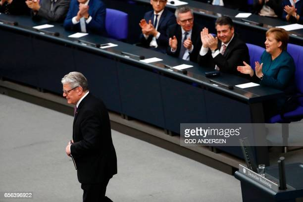 Germany's outgoing President Joachim Gauck leaves as German Chancellor Angela Merkel German Vice Chancellor and Foreign Minister Sigmar Gabriel and...
