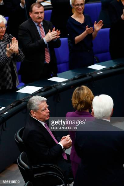 Germany's outgoing President Joachim Gauck receives applause prior the swearingin ceremony of the new German President FrankWalter Steinmeier at the...