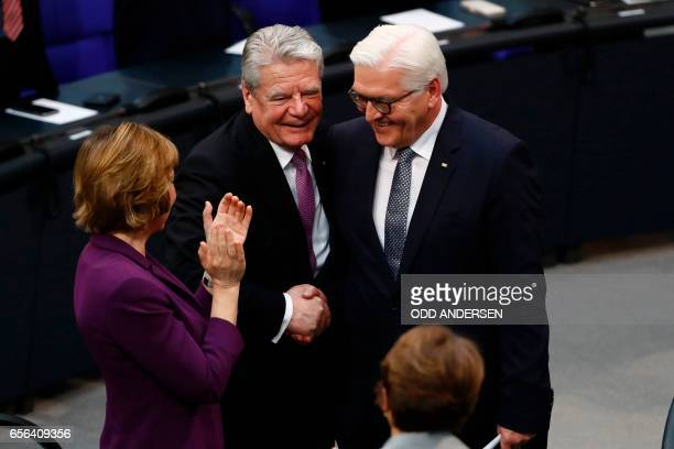 Germany's outgoing President Joachim Gauck shakes hands with the new German President FrankWalter Steinmeier after he delivered a speech during the...