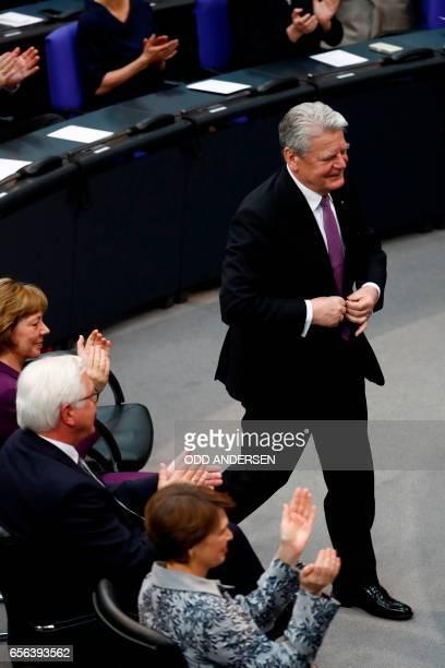Germany's outgoing President Joachim Gauck stands as his partner Daniela Schadt Germany's new President FrankWalter Steinmeier and his wife Elke...