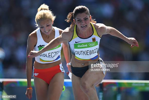 Germany's Pamela Dutkiewicz competes in the Women's 100m Hurdles Round 1 during the athletics event at the Rio 2016 Olympic Games at the Olympic...