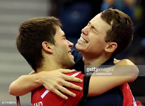 Germany's Patrick Franziska and Denmark's Jonathan Groth celebrate their victory over Poland's Jakub Dyjas Daniel Gorak in 'Tuskecsarnok' sports hall...