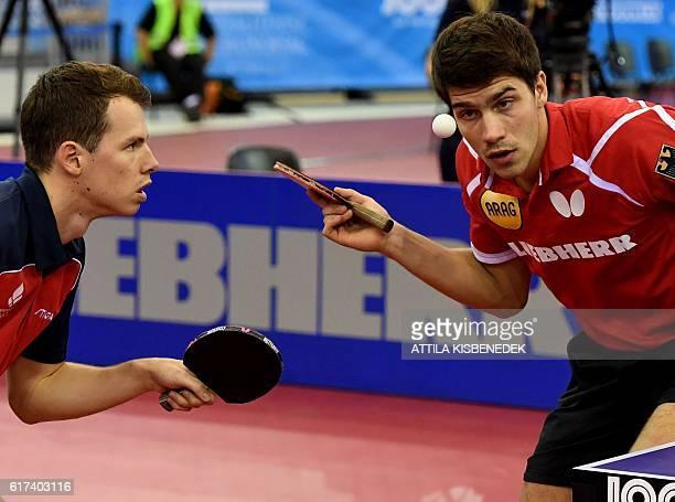 Germany's Patrick Franziska and Denmark's Jonathan Groth play against Poland's Jakub Dyjas and Daniel Gorak in Budapest on October 23 2016 during the...