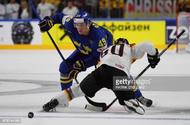 Germany´s Patrick Hager and Sweden´s Victor Rask vie for the puck during IIHF Icehockey world championship first round match between Sweden and...