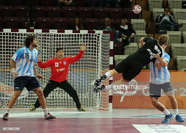 Germany's Paul Drux takes a shot on goal during the 24th Men's Handball World Championships preliminary round Group D match between Germany and...