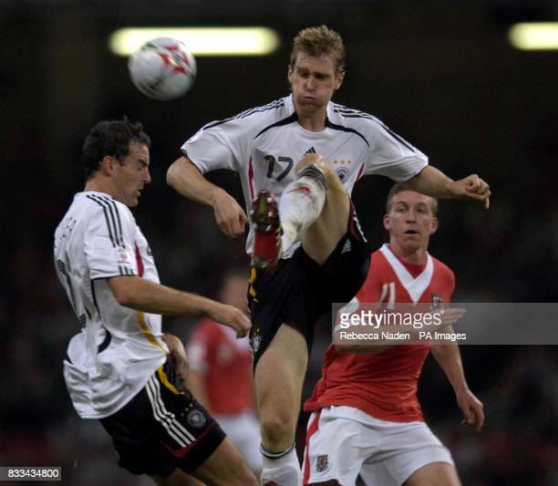 Germany's Per Mertesacker in action with Wales' Freddy Eastwood during the UEFA European Championship Qualifying match at Millennium Stadium Cardiff