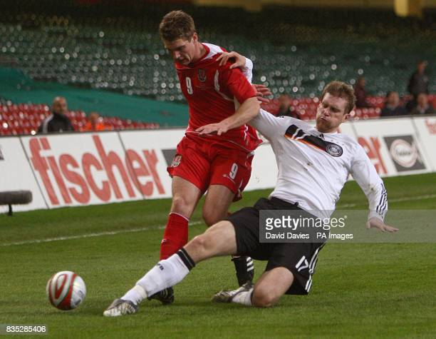 Germany's Per Mertesacker takles Wales'Sam Vokes
