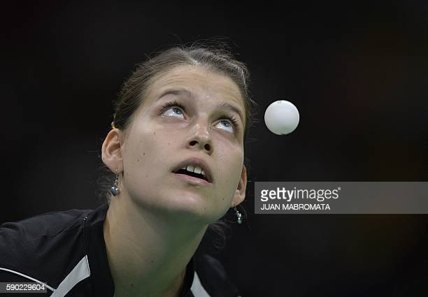 Germany's Petrissa Solja eyes the ball as she serves in the women's team gold medal final table tennis match against China at the Riocentro venue...