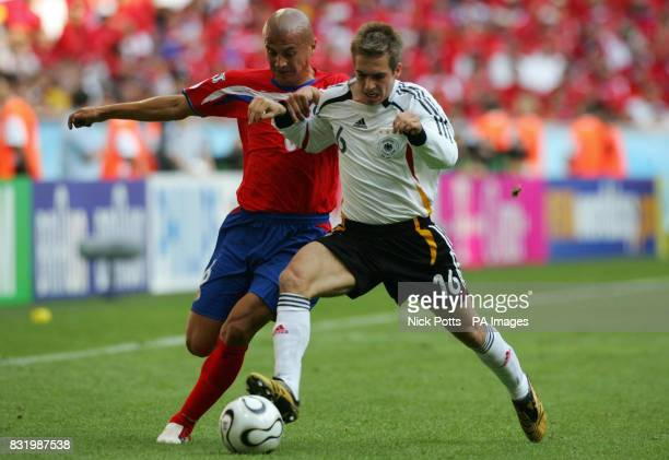 Germany's Philip Lahm tussles for the ball with Costa Rica's Danny Fonseca during the Group A World Cup match at the FIFA World Cup Stadium Munich...