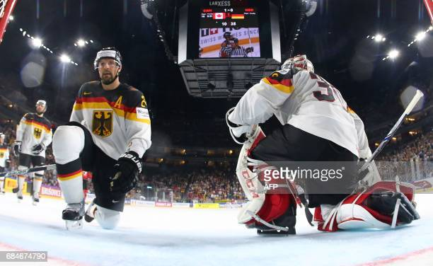 Germany's Philipp Grubauer and and Dennis Seidenberg react during the IIHF Men's World Championship Ice Hockey quarterfinal match between Canada and...