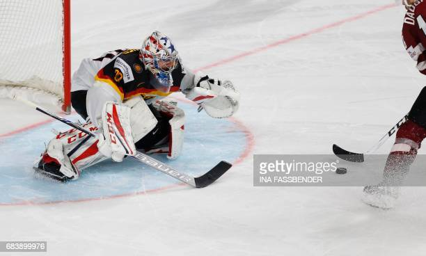 Germany's Philipp Grubauer eyes the puck during the penalty shootout of the IIHF Men's World Championship Ice Hockey match between Germany and Latvia...