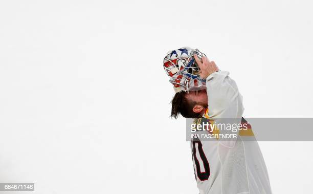 Germany's Philipp Grubauer reacts after the IIHF Men's World Championship Ice Hockey quarterfinal match between Canada and Germany in Cologne western...