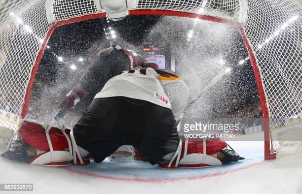 Germany's Philipp Grubauer vies with Latvia's Kaspars Daugavins during the IIHF Men's World Championship Ice Hockey match between Germany and Latvia...