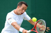 Germany's Philipp Kohlschreiber plays a backhand shot during his fourth round men's singles victory over US player Brian Baker on day eight of the...