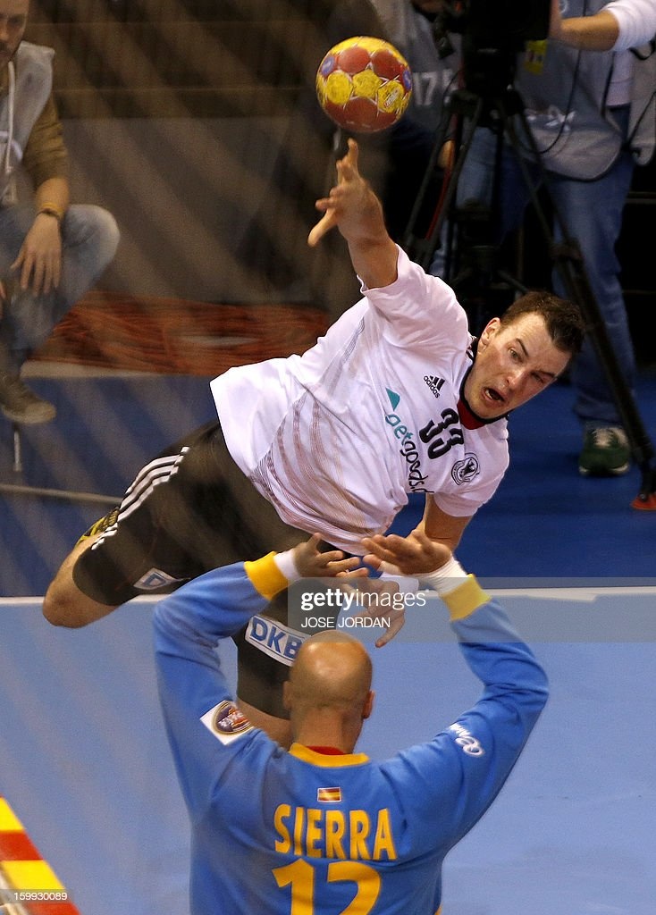 Germany's pivot Christoph Theuerkauf shoots at Spain's goalkeeper Jose Manuel Sierra during the 23rd Men's Handball World Championships quarterfinal...