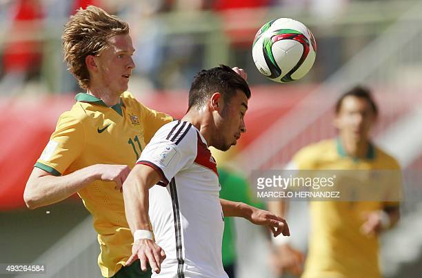 Germany's player Erdinc Karaka vies for the ball with Lucas Derrick of Australia during their FIFA U17 World Cup Chile 2015 football match at Nelson...