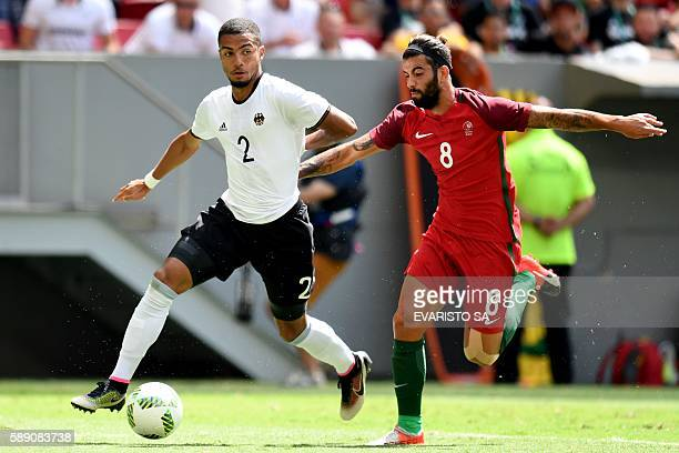 Germany's player Jeremy Toljan vies for the ball with Portugal's player Sergio Oliveira during the Rio 2016 Olympic Games Quarterfinals men's...