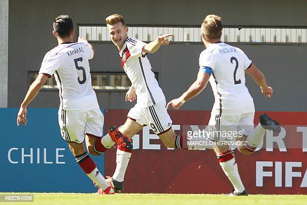 Germany's player Johannes Eggestein celebrates with teammates after scoring against Australia during their FIFA U17 World Cup Chile 2015 football...