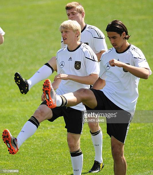 Germany's players Andreas Beck Toni Kroos and Sami Khedira take part in a training session in Appiano May 31 2010 The German football team is...