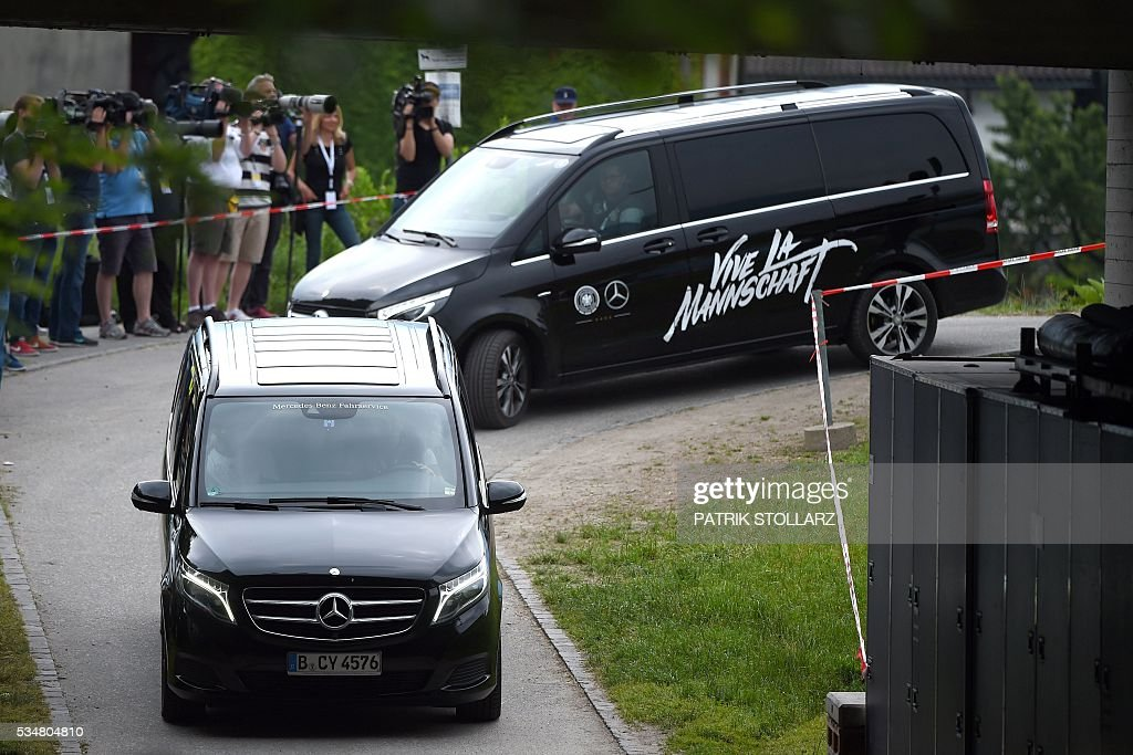 Germany's players arrive at a training session as part of the team's preparation for the upcoming Euro 2016 European football championships, on May 28, 2016 in Ascona. / AFP / PATRIK