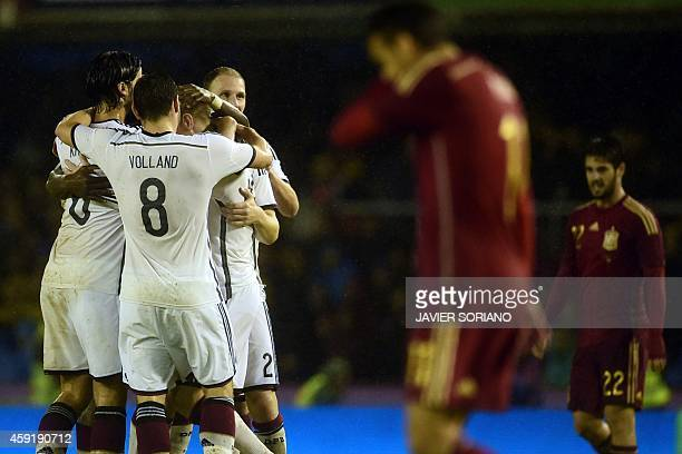 Germany's players celebrate after scoring during a friendly football match Spain vs Germany at the Balaidos stadium in Vigo on November 18 2014 AFP...