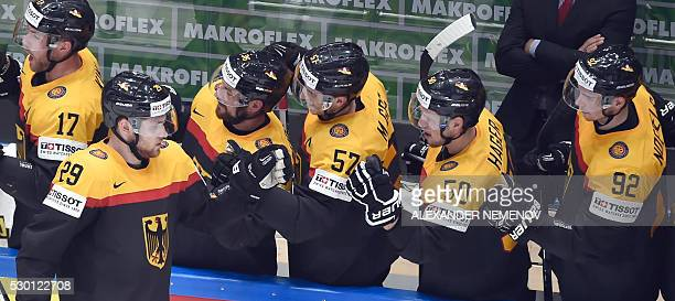 Germany's players celebrate after scoring during the group B preliminary round game Slovakia vs Germany at the 2016 IIHF Ice Hockey World...