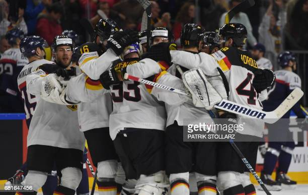 Germany´s players celebrate after the IIHF Ice Hockey World Championships first round match between Slovakia and Germany in Cologne western Germany...