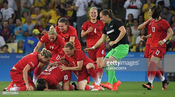 Germany's players celebrate after their team's victory over Sweden during the Rio 2016 Olympic Games women's football Gold medal match at the...